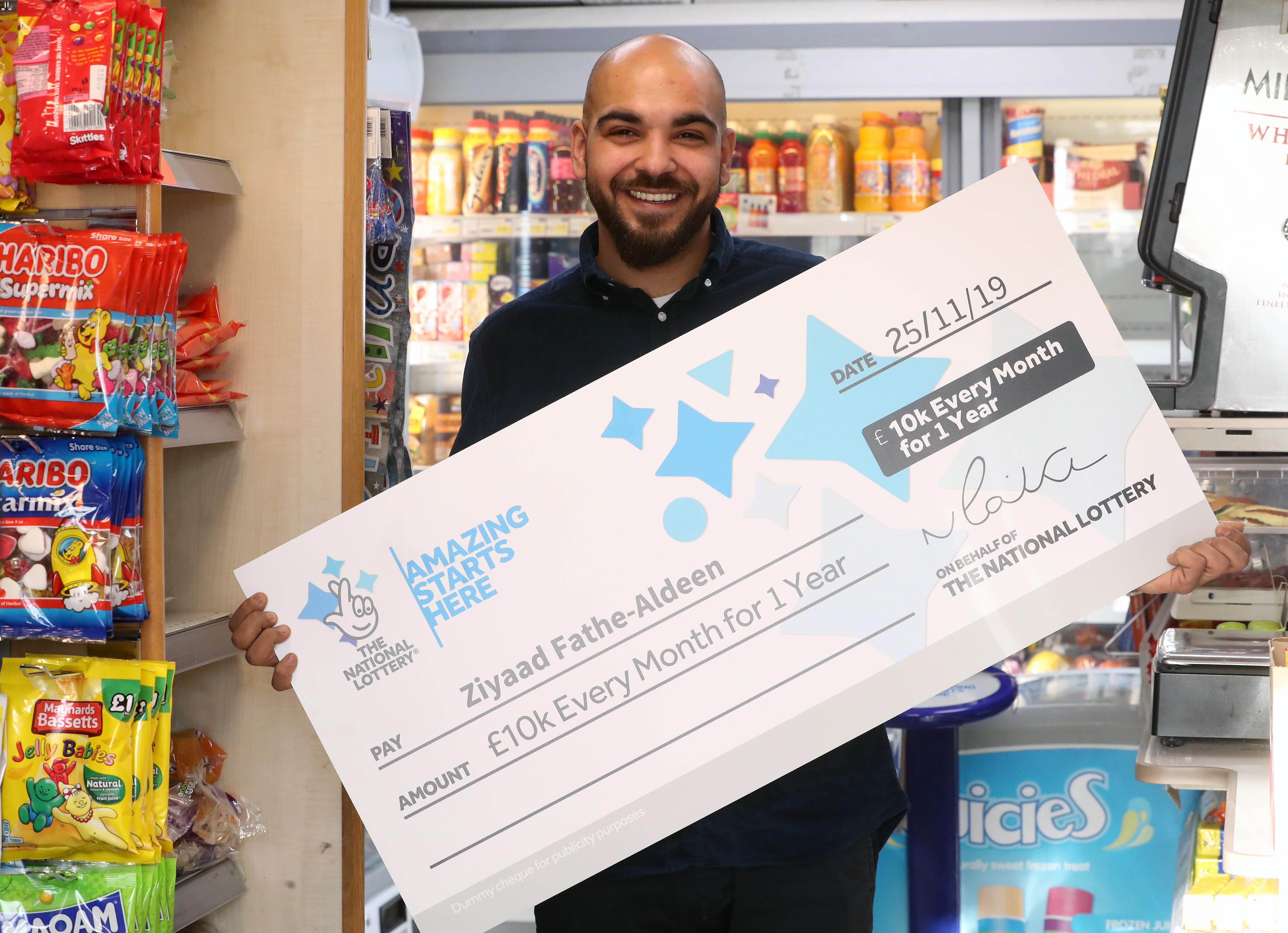 Shop assistant wins £10,000 a month for a year and plans world tour